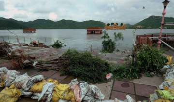7 villagers rescued from flooded river in bundi -...