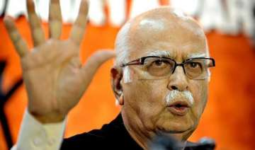 advani attacks congress for slanderous campaign...