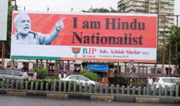 bjp puts up posters projecting narendra modi as...