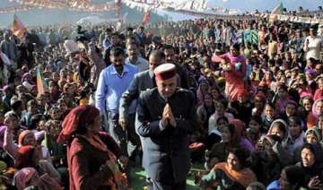 dhumal takes on cong with induction chulhas -...