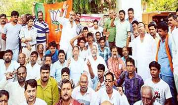 bjp staged dharnas demanding arrest of ips...