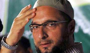 congress leader attack owaisi surrenders before...