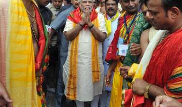 pm modi offers prayers at jagannath temple in...