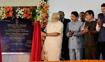 pm modi lays foundation stone of jnpt s rs 7 900...