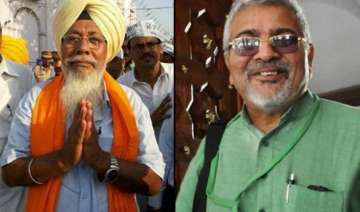 aap suspends mps dharamavira gandhi and harinder...