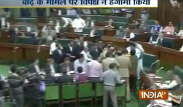 uproar in j k assembly over flood relief - India...