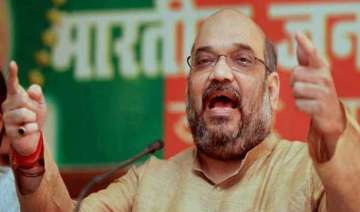amit shah launches offensive against congress...