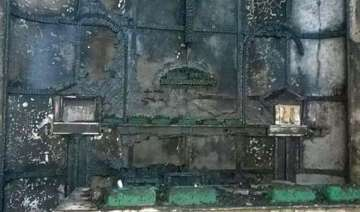 mps condemn burning down of church in delhi -...