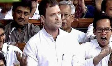 rahul accuses govt of trying to hand over...