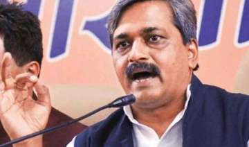delhi poll satish upadhyay s supporters protest...