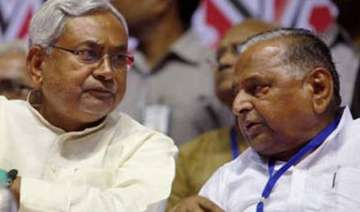 amid confusion over merger nitish asks mulayam to...