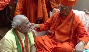 pm modi to meet his guru swami atmasthanand...
