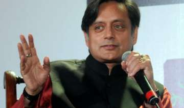 tharoor takes a jibe at modi says it is time for...