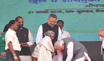 pm modi touches the feet of 104 yr old woman who...