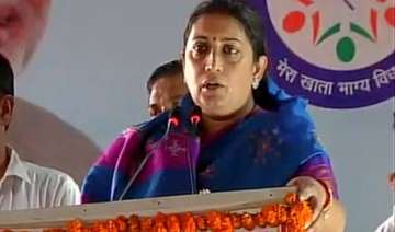 smriti irani alleges land scam by congress in...