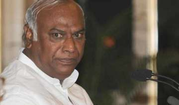 kharge questions sudden hike in rail fares -...