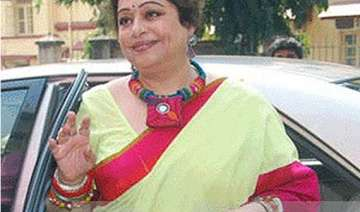 kirron kher greeted with black flags in...
