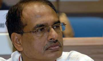 mp polls will be a fight between chouhan and...