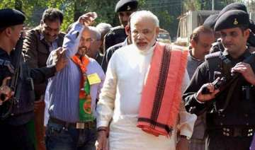 modi arrives in hyderabad amid tight security -...
