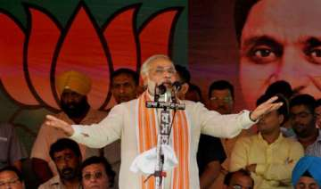 modi comfortable in first big outing invokes...