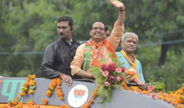 modi s images finally find place in chouhan s...