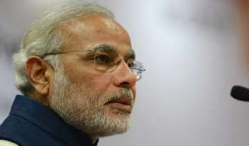 modi welcomes advani s decision to stay on -...
