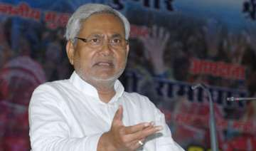 nitish takes dig at modi for trumpeting on...
