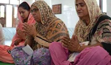 parkash badal families of abducted indian workers...