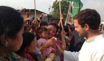 rahul questions bjp s plan on development in...