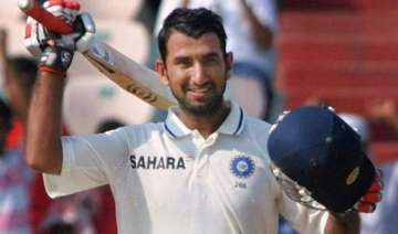pujara hits his maiden double ton yuvraj out for...