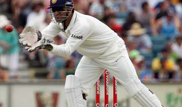 dhoni handed one match ban for slow over rate -...