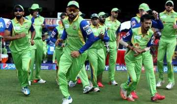 ipl 8 rcb through to play offs after match called...