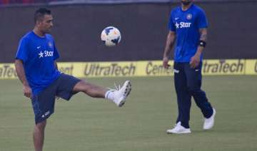 is it virat kohli who is waiting for dhoni with...