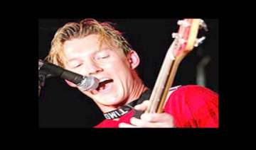 brett lee comes to india holding a guitar - India...