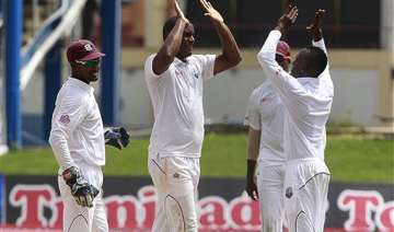 latham hits 82 but taylor leads windies fightback...