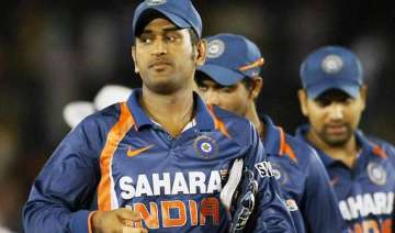 modest dhoni leads by example for expectant india...