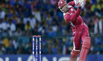 samuels bats and bowls west indies to victory -...