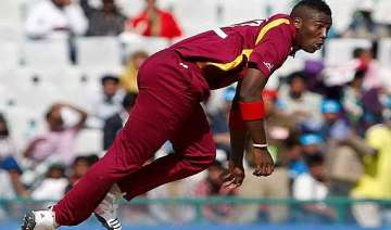 windies captain coach back andre russell to...
