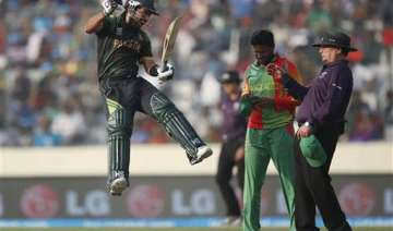 icc world t20 shehzad ton sets up easy win for...