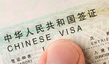 beijing defends stapled visas says policy...