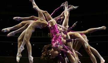 number of gymnasts reduced to four in team...