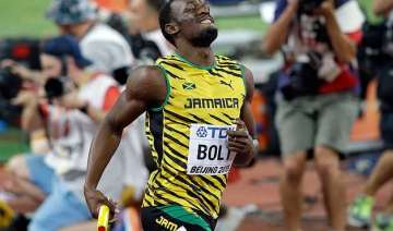 usain bolt wins world treble with relay gold -...