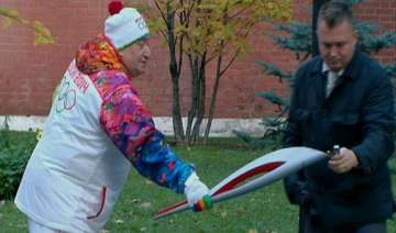 winter olympic torch begins 123 day relay from...