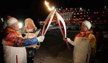 olympic torch reaches north pole - India TV