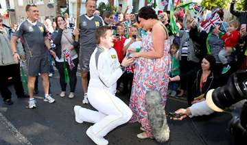 olympic torch bearer proposes during relay -...
