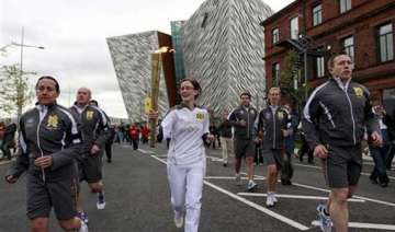 olympic torch starts 5 day northern ireland tour...