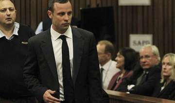 pistorius enters courtroom for start of trial. -...