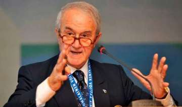 world gymnastics body expels top olympic official...