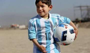 messi replaces five year old afghan boy s plastic...