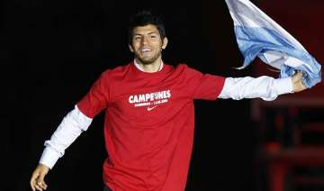 aguero flies into manchester to seal city switch...